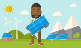 African man holding a solar panel Royalty Free Stock Photo