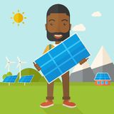 African man holding a solar panel Stock Photography
