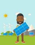 African man holding a solar panel Royalty Free Stock Images