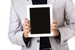 African man holding a tablet Royalty Free Stock Photos