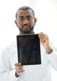 African man holding tablet for your message Royalty Free Stock Photography
