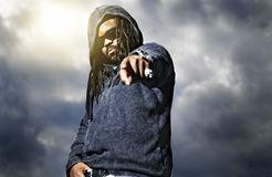 African man in hoodie pointing at camera Royalty Free Stock Photos