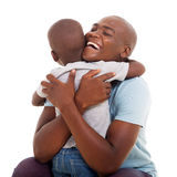 African man hugging son Royalty Free Stock Images
