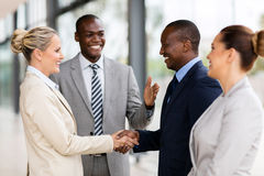 African man introducing businesswoman Royalty Free Stock Photography