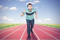 African man jogging on the running track Stock Photography