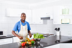 African man in kitchen. Young african man in kitchen Stock Images
