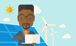 African man with laptop in solar panel Stock Photography