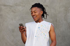 African man laughing with mobile phone Stock Photo