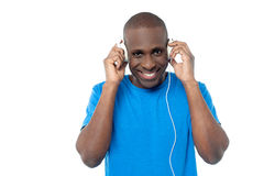 African man listen to music with headphones. Handsome man listening to music with headphones Royalty Free Stock Image