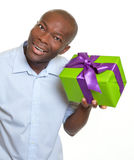 African man listening on a gift Royalty Free Stock Photos