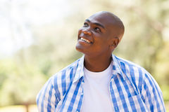 African man looking up. Cheerful young african man looking up Royalty Free Stock Images