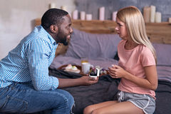 African man making a proposal to his girlfriend Royalty Free Stock Image