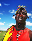 African man of Masai Mara tribe. AFRICA, KENYA, MASAI MARA, NOVEMBER 12: portrait on an African man of Masai Mara tribe village, guy wears traditional tribal Royalty Free Stock Images
