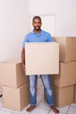 African man moving. Young single african american man moving apartment Stock Images