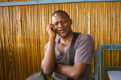 African man on phone. An African man holds a conversation with a mobile phone royalty free stock photos