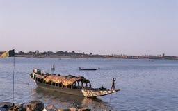 African man pinnace navigating the river Niger Stock Images
