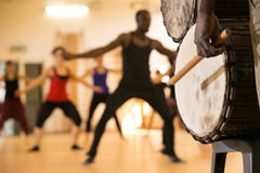 African man playing drum. Dance class with instructor and close up of African drums Stock Photo