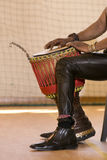 African man playing traditional instruments Stock Photo