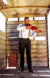African man playing violin Royalty Free Stock Photos