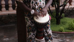 African man plays African drums stock video