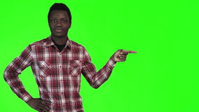African man pointing on green stock video footage