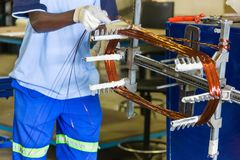 African man rewinding electric motor. Rewinding an electric motor, African man at work stock photography