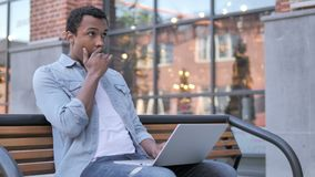 African Man in Shock while Working on Laptop Outdoor. 4k high quality, 4k high quality stock video