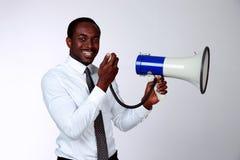 African man shouting through a megaphone Royalty Free Stock Image