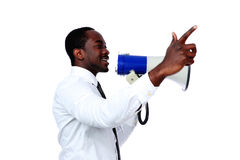 African man shouting through a megaphone. Isolated on a white background Stock Photo