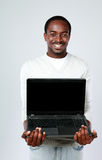 African man showing blank laptop screen Stock Photography