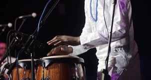 African man singing and playing ethnic drums stock video footage
