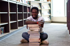 African man sitting on floor at library Stock Photography