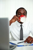 African man sitting at his workplace Royalty Free Stock Photos