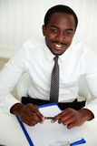 African man sitting at the table Stock Images