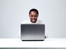 African man sitting at the table Royalty Free Stock Photography