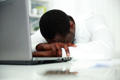 African man sleeping at his workplace Stock Photos