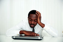 African man sleeping at his workplace Stock Image