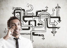African man with smartphone and arrow maze Royalty Free Stock Photography