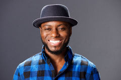 African man smiling with hat and plaid shirt Royalty Free Stock Photography