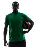 African man soccer player  holding football silhouette Royalty Free Stock Images