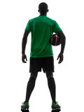 African man soccer player  holding football silhouette Royalty Free Stock Photos