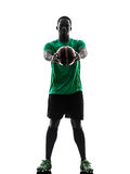 African man soccer player  holding showing football silhouette Stock Photos