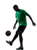 African man soccer player  juggling silhouette Royalty Free Stock Images