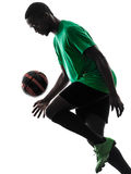 African man soccer player  juggling silhouette Royalty Free Stock Image