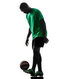 African man soccer player  juggling silhouette Royalty Free Stock Photo
