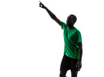 African man soccer player pointing silhouette Stock Images