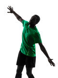 African man soccer player  scoring silhouette. One african man soccer player scoring green jersey in silhouette  on white background Stock Photography
