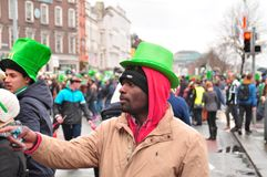 St patricks day Dublin. An african man at the st patricks day parade in dublin ireland europe Stock Image