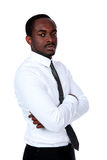 African man standing with arms folded Stock Image