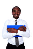 African man standing with blue folder. SMiling african man standing with blue folder isolated on white background stock photos